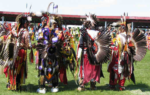 Powwow dancers wearing Bustles